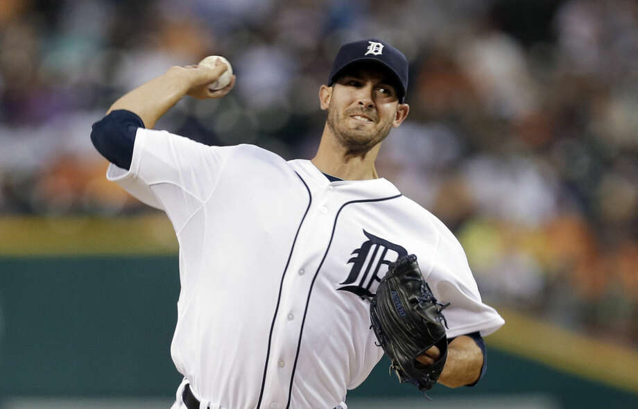 Detroit Tigers pitcher Rick Porcello throws against the New York Yankees in the first inning of a baseball game in Detroit Tuesday, Aug. 26, 2014. (AP Photo/Paul Sancya)