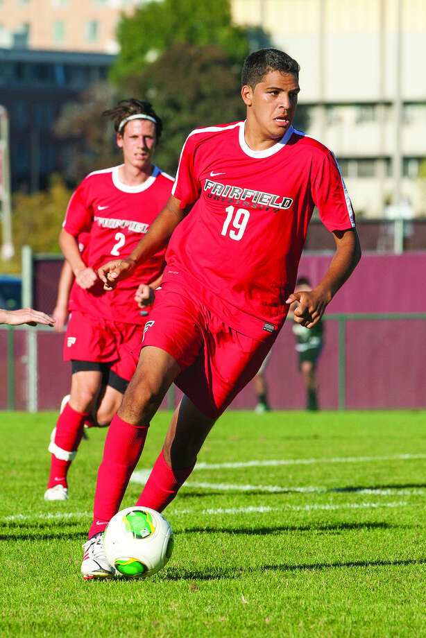 Norwalk High graduate Jake Zuniga dribbles the ball upfield during a game last season. Zuniga, a midfielder, is going into his final season at Fairfield University and is hoping to bring home a second MAAC championship.