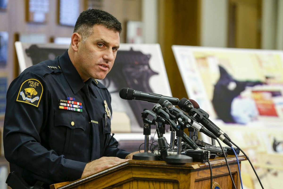 Omaha Police Chief Todd Schmaderer speaks in front of images from security video and an enlargement of an airsoft pistol used in the robbery of a Wendy's restaurant on Tuesday, during a news conference at police headquarters in Omaha, Neb., Wednesday, Aug. 27, 2014. Bryce Dion, a sound technician with the ?
