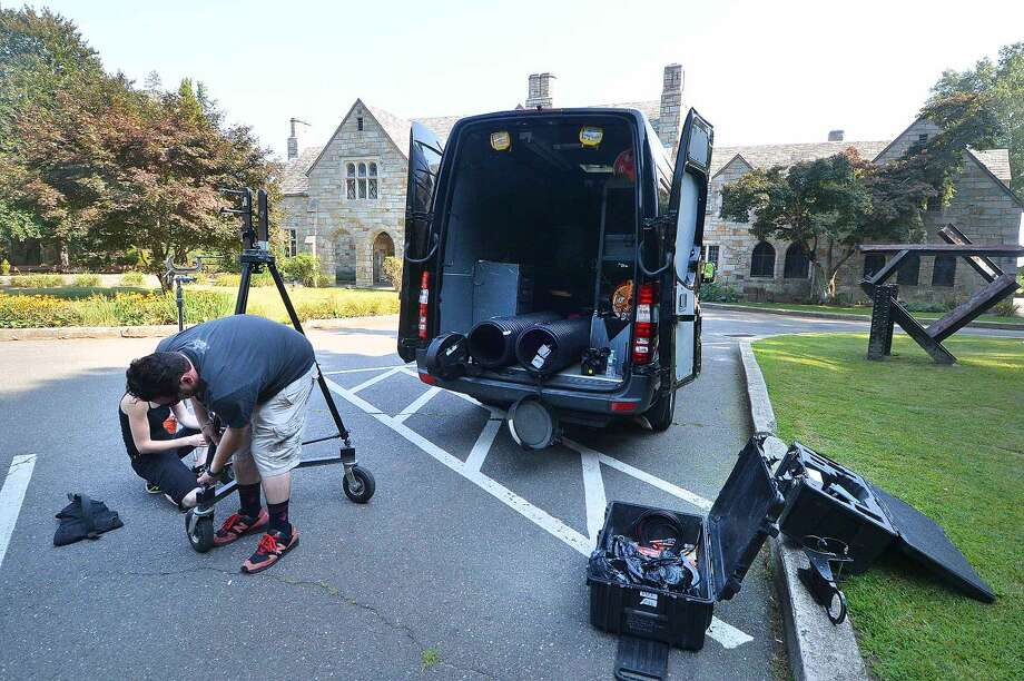 Hour Photo/Alex von Kleydorff Crews set out production equipment ready for filming an episode of Ghost Hunters at Gallaher estate in Cranbury Park on Wednesday