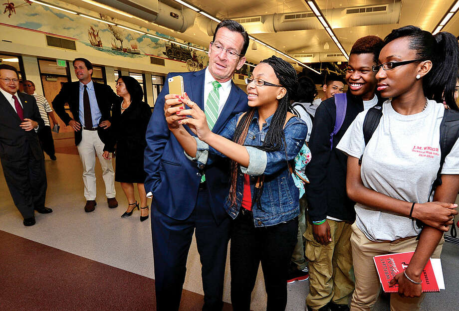 Gov. Dannel P. Malloy takes a selfie with student Chanya Champagne following the J.M. Wright Technical School opening day ribbon cutting ceremony Wednesday morning.