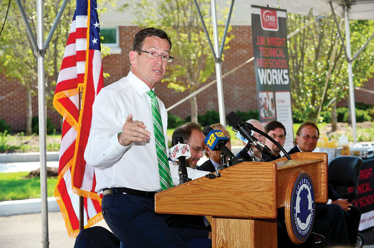 Gov. Dannel P. Malloy makes remarks during the J.M. Wright Technical High School opening day ribbon cutting ceremony Wednesday morning.