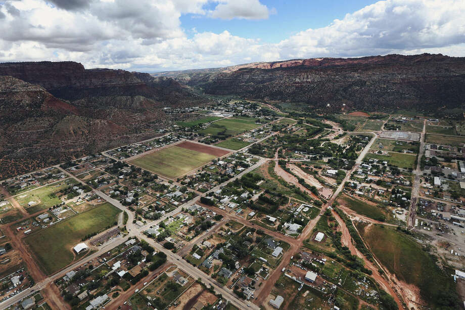 FILE - This Wednesday, Sept. 16, 2015, file photo, shows an aerial photo of Hildale, Utah. The secluded polygamous towns tucked between stunning red-rock cliffs have survived for more than 100 years, despite Utah and Arizona's efforts to dismantle them and expose abuses. (Scott G Winterton/The Deseret News via AP, File) SALT LAKE TRIBUNE OUT; MAGS OUT; NO SALES; MANDATORY CREDIT