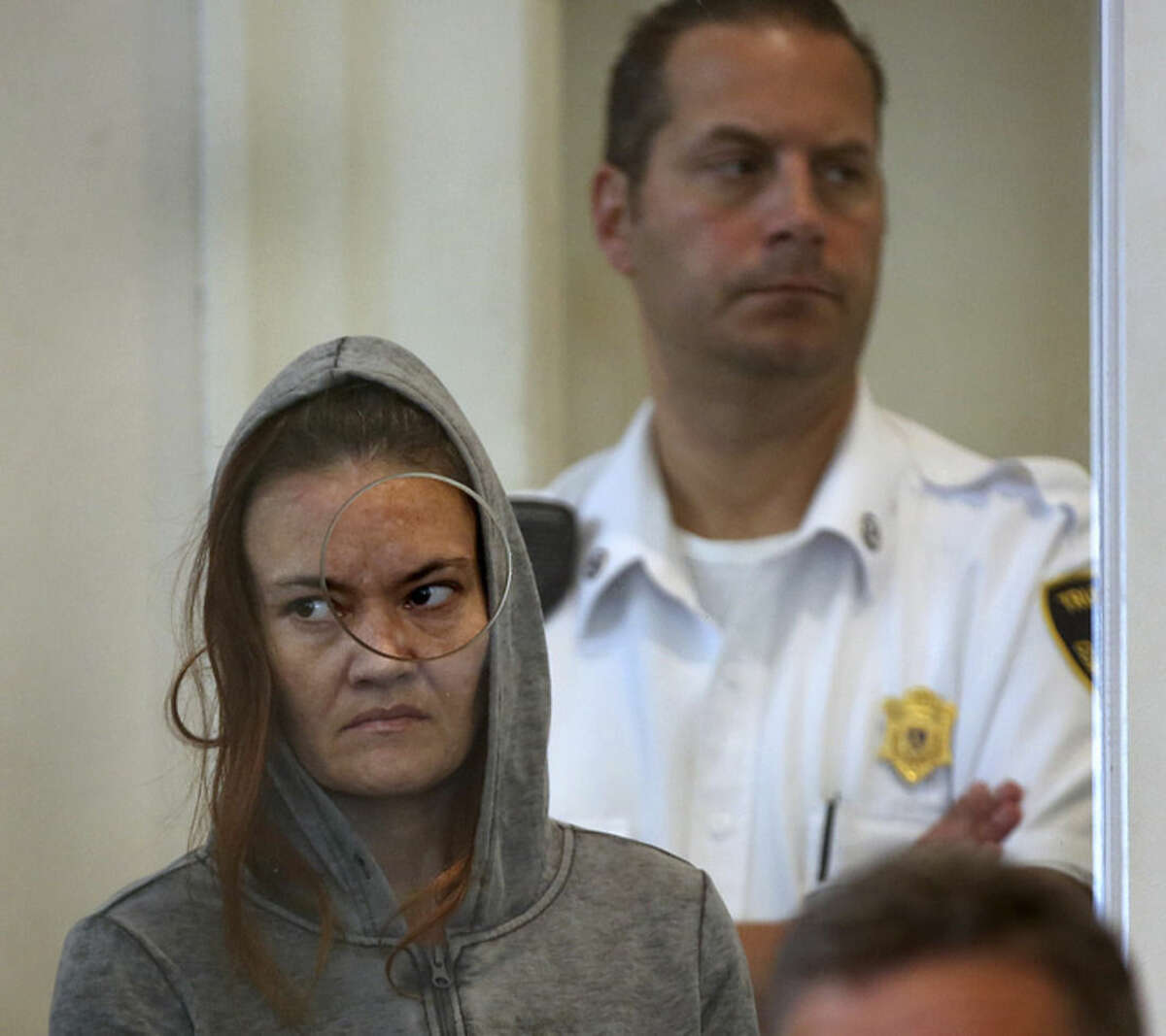 Pat Greenhouse/The Boston Globe via AP, Pool Rachelle Dee Bond is arraigned on charges of acting after the fact in helping to dispose of the body of her daughter, the girl dubbed Baby Doe, in Dorchester District Court, on Monday, Sept. 21, in Boston. Bella Bond, 2, was known as Baby Doe until she was identified almost three months after her remains washed up inside a trash bag on a Boston Harbor beach. The judge ordered Bond held on $1 million cash bail and Bond's boyfriend, Michael McCarthy, held without bail on murder charges.