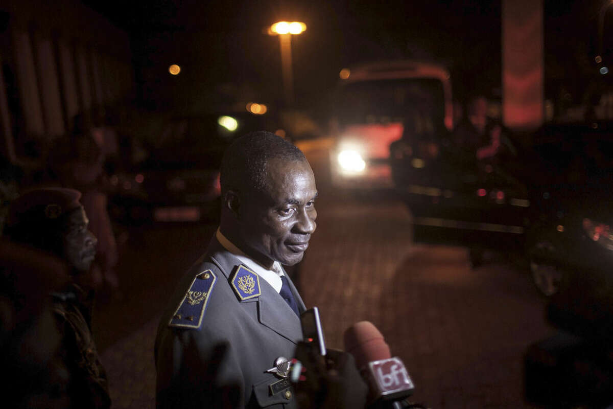 In this photo taken on Saturday, Sept. 19, 2015, Gen. Gilbert Diendere, who was named leader of Burkina Faso on Thursday, speak to media in Ouagadougou, Burkina Faso. West African mediators late Saturday hinted at a breakthrough in Burkina Faso's political crisis after a military coup brought a general to power less than a month before scheduled elections. (AP Photo/Theo Renaut)