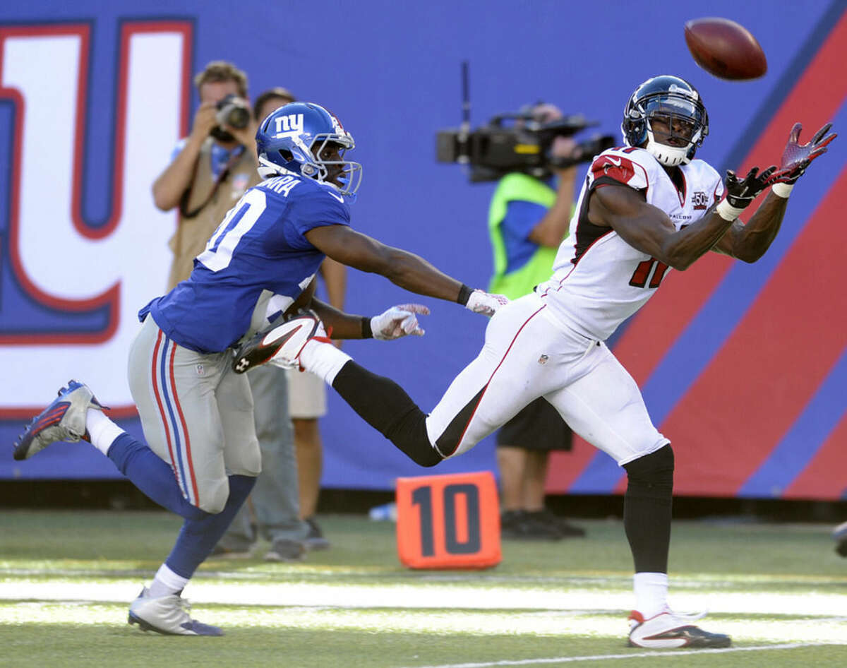 Atlanta Falcons wide receiver Julio Jones, right, makes a catch near the end zone on a pass from quarterback Matt Ryan, not pictured, as New York Giants cornerback Prince Amukamara defends on the play during the second half of an NFL football game, Sunday, Sept. 20, 2015, in East Rutherford, N.J. (AP Photo/Bill Kostroun)