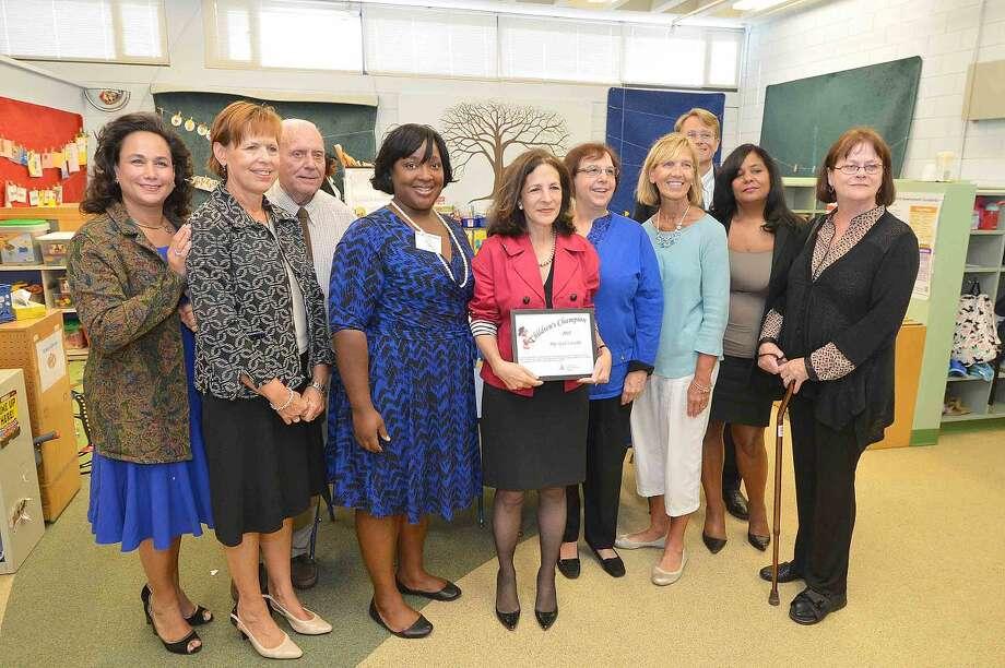 Hour Photo/Alex von Kleydorff State Rep Gail lavielle accepts a Childrens Champion award at the Naramake Family Resource Center