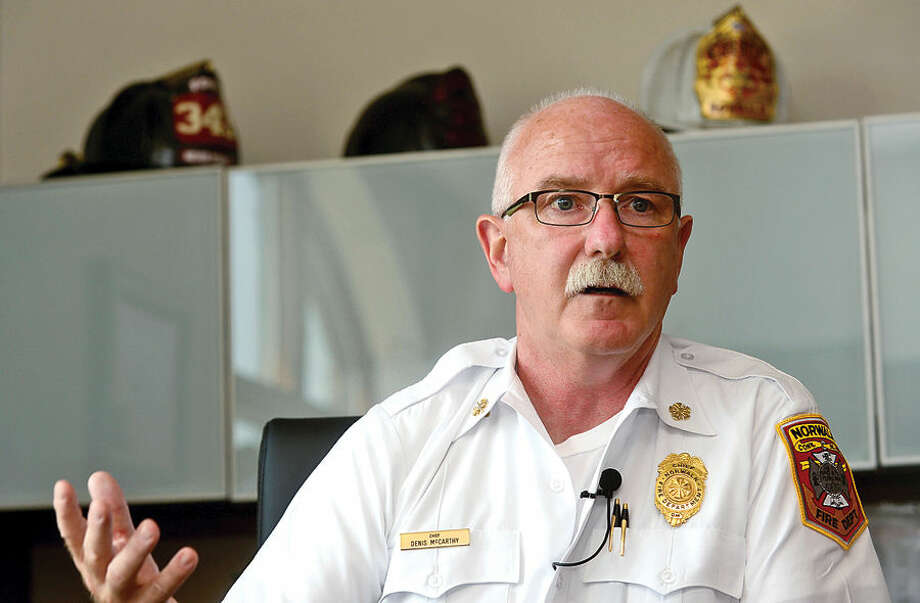 Hour photo / Erik Trautmann Fire Chief Denis M. McCarthy speaks to The Hour about his 10 years heading the Norwalk Fire Department.