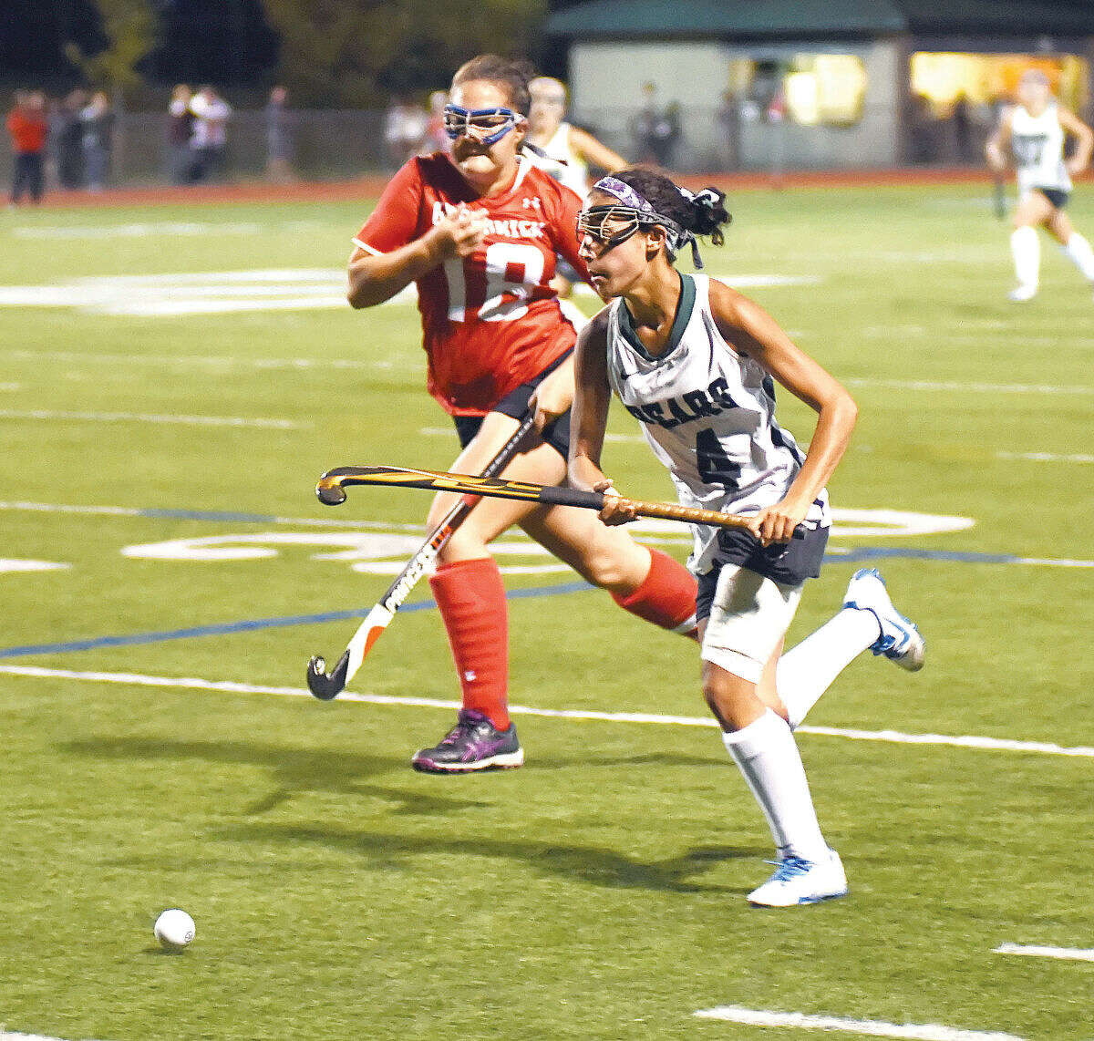 """Hour photo/John Nash - Marissa """"Mouse"""" Mastrianni (4) of Norwalk races past the Greenwich defense during Monday's FCIAC field hockey game at Testa Field in Norwalk. The Bears won the game, 2-0."""