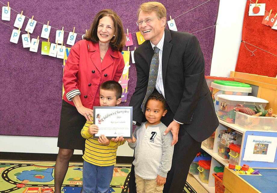 Hour Photo/Alex von Kleydorff State Rep Gail lavielle accepts a Childrens Champion award from Connecticut Early Childhood Alliance Executive Director Merrill Gay and some of the Pre K students at the Naramake Family Resource Center