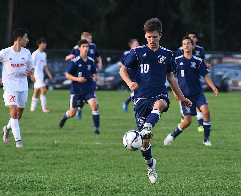 Wilton's Jack Brandt (10) plays the ball up field during Monday's game at Fairfield Warde.