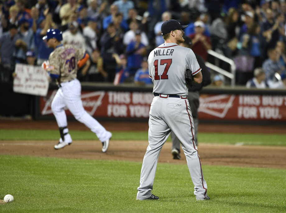 Atlanta Braves starting pitcher Shelby Miller (17) looks towards the outfield as New York Mets' Michael Conforto (30) rounds third base after hitting a solo home run in the second inning of a baseball game, Monday, Sept. 21, 2015, in New York. (AP Photo/Kathy Kmonicek)