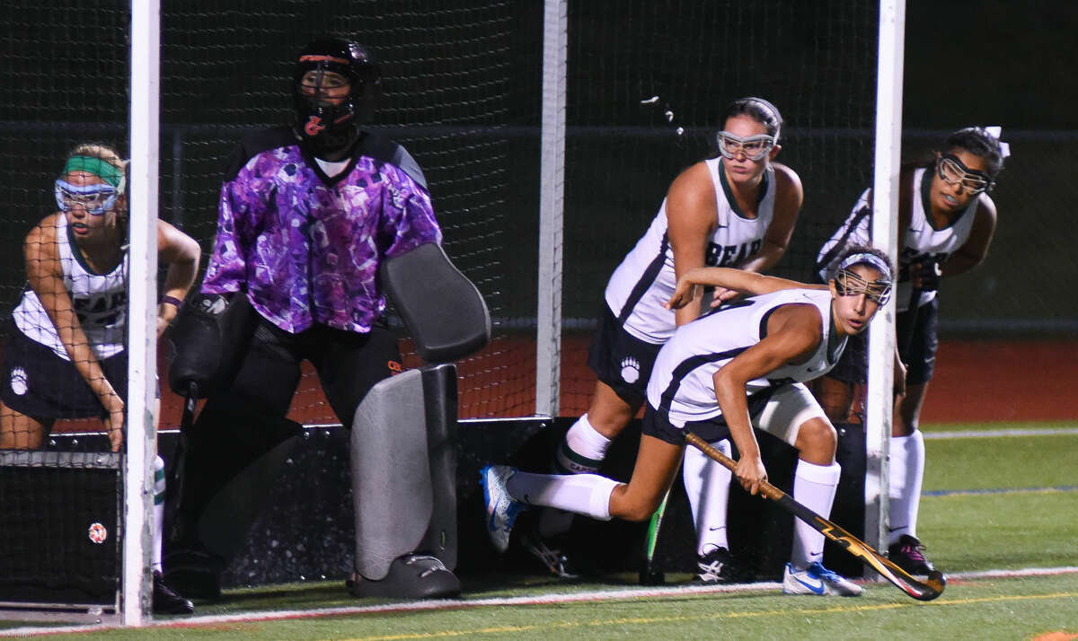 Hour photo/John Nash - Action from the Norwalk vs. Greenwich field hockey game played Monday, Sept. 21, at Testa Field in Norwalk.