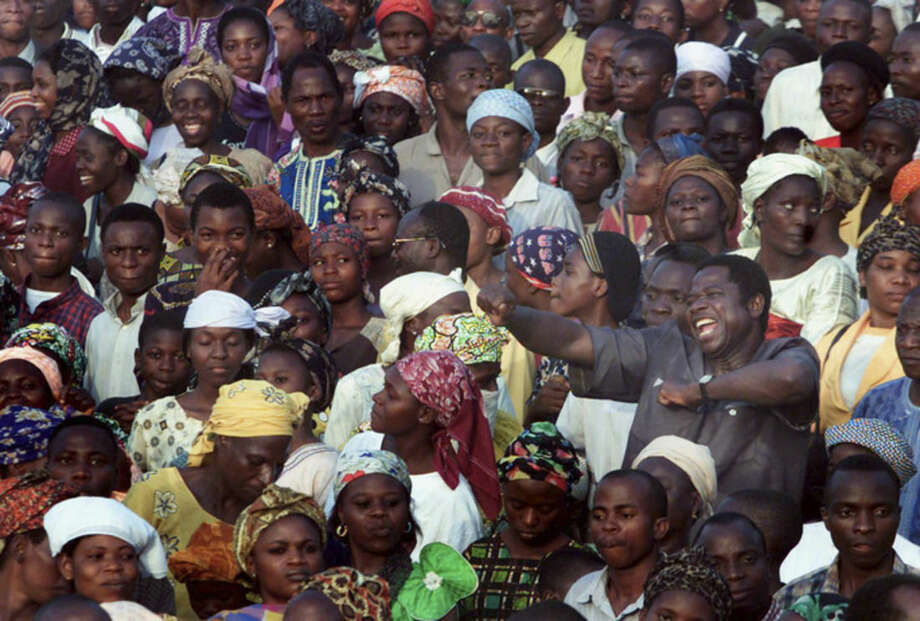 ADVANCE FOR USE SUNDAY, AUG. 24, 2014, AND THEREAFTER- FILE - In this Dec. 5, 2001, file photo a man sings and dances during Reinhard Bonnke's 'Great Gospel Crusade' in Osogbo, Nigeria. After preaching in Miami, Bonnoke, a registered Republican, was preceded on stage by GOP Gov. Rick Scott of Florida, who received loud applause when he declared Christ as his savior. (AP Photo/Christine Nesbitt, File)