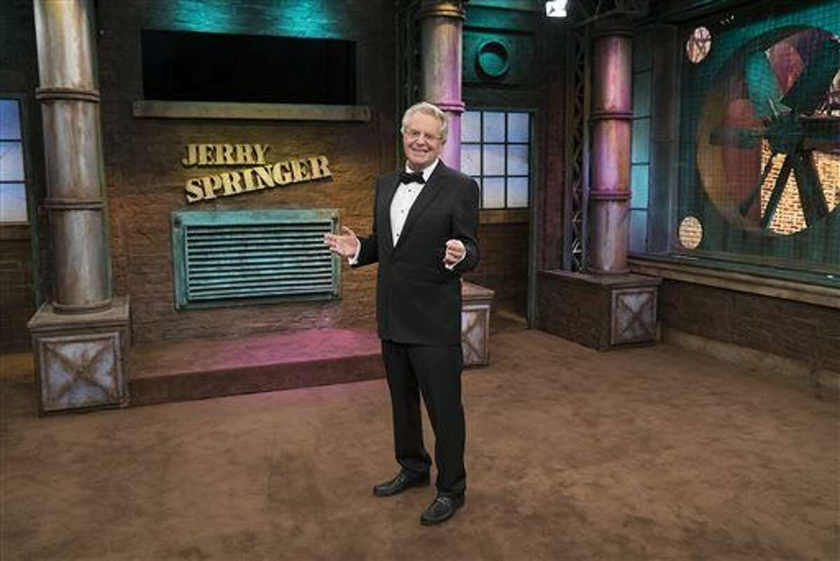 In this image released by NBC, host Jerry Springer appears at the taping of his 25th Anniversary show in Stamford, Conn.Springer, 71, is all aboard for another year on the crazy train, and plans to stay as long as he's healthy. (Virginia Sherwood/NBC via AP)