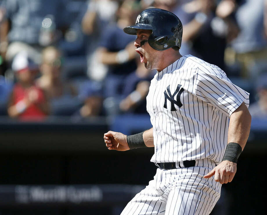 New York Yankees Francisco Cervelli reacts after scoring on Ichiro Suzuki's sixth-inning, two-run single off Chicago White Sox starting pitcher Chris Sale in a baseball game at Yankee Stadium in New York, Sunday, Aug. 24, 2014. (AP Photo/Kathy Willens)