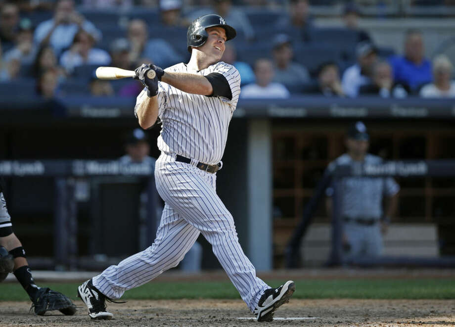 New York Yankees' Brian McCann hits a 10-inning three-run home run off Chicago White Sox relief pitcher Jake Petricka in a baseball game at Yankee Stadium in New York, Sunday, Aug. 24, 2014. (AP Photo/Kathy Willens)
