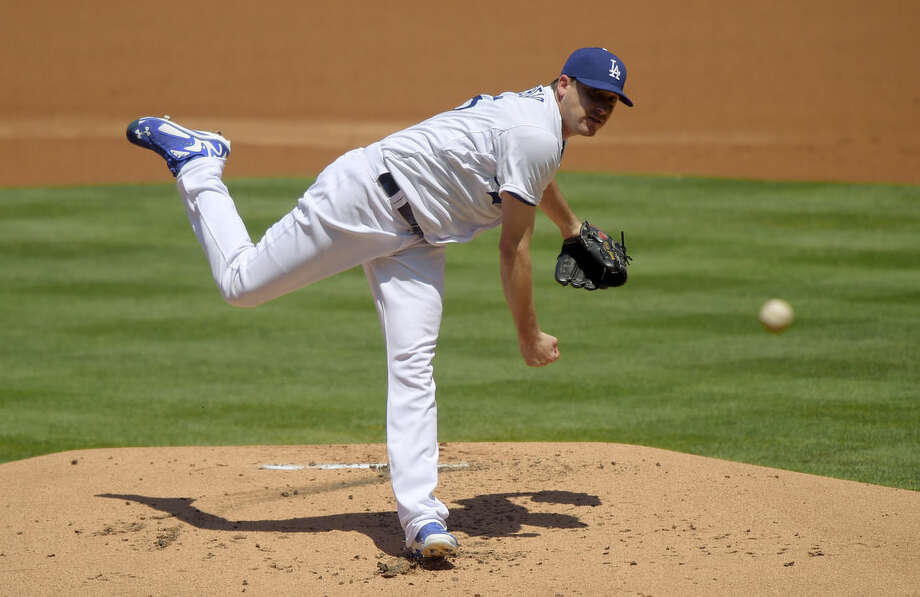 Los Angeles Dodgers starting pitcher Kevin Correia throws to the plate during the second inning of a baseball game against the New York Mets, Sunday, Aug. 24, 2014, in Los Angeles. (AP Photo/Mark J. Terrill)