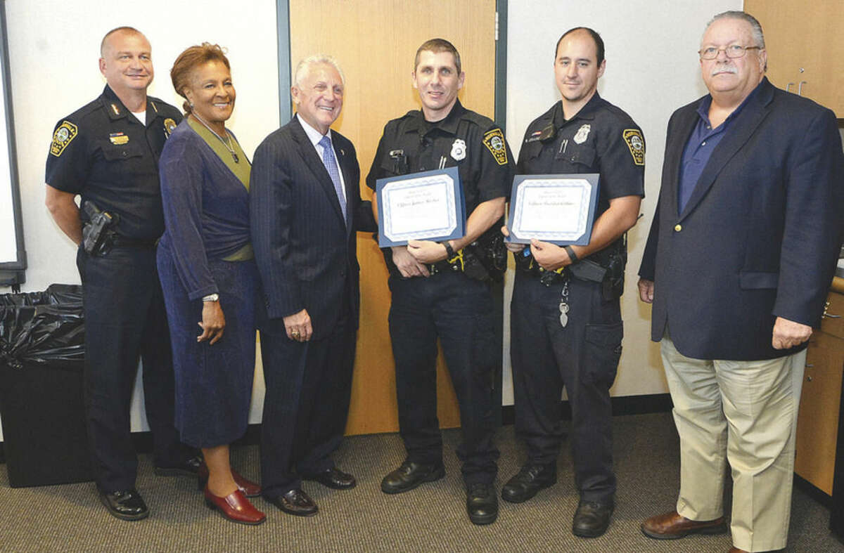 Hour photo/Alex von Kleydorff Police Chief Tom Kulhawik, Police Commissioner Fran Collier Clemmons, Mayor Harry Rilling and Charles Yost honor two of the department's Officers of the Month -- James Mosher and Brendan Collins -- on Tuesday.