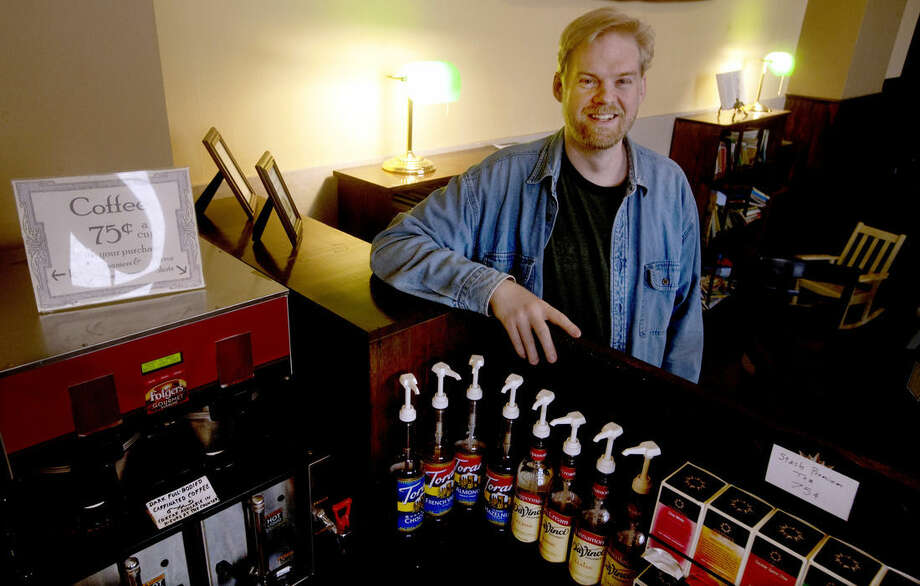 David Brekke, shown in an Aug. 22, 2014 photo, is the impetus behind 'The Vault', a self-serve coffee shop in downtown Valley City, North Dakota. According to Brekke, small-town living is what allows the North Dakota coffee shop to operate on the honor system. (AP Photo/Bruce Crummy)