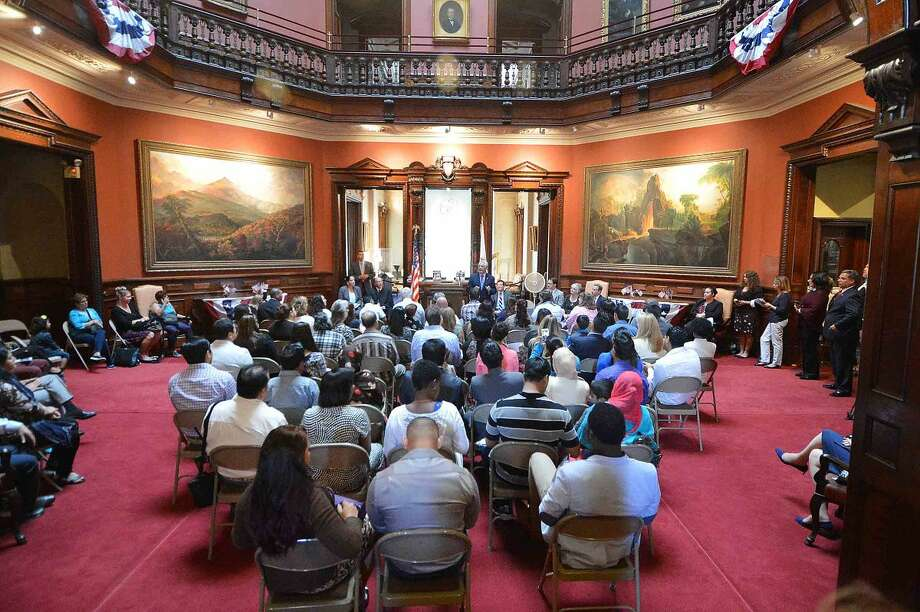 Hour Photo/Alex von Kleydorff A special Naturalization ceremony was held by the U.S. Citizenship and Immigration Services for 25 people to become U.S. citizens at Lockwood Matthews Mansion Museum in Norwalk on Tuesday