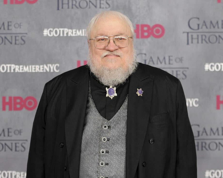 """FILE - In this March 18, 2014 file photo, author and co-executive producer George R. R. Martin attends the """"Game of Thrones"""" fourth season premiere in New York. Martin's latest written installment of the series, """"The World of Ice & Fire: The Untold History of Westeros and the Game of Thrones,"""" will be released on Oct. 28, 2014. (Photo by Evan Agostini/Invision/AP, File)"""