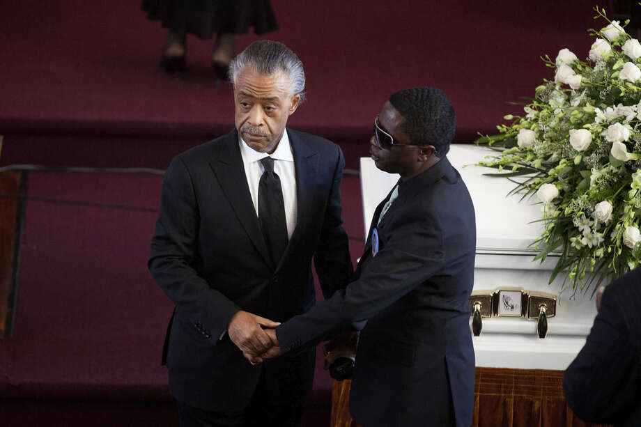 FILE - In this Feb. 18, 2012 file photo, civil rights activist Al Sharpton shakes the hand of Franclot Graham, father of Ramarley Graham, 18, who was shot in his home by a police officer in the Bronx borough of New York. (AP Photo/John Minchillo, File)
