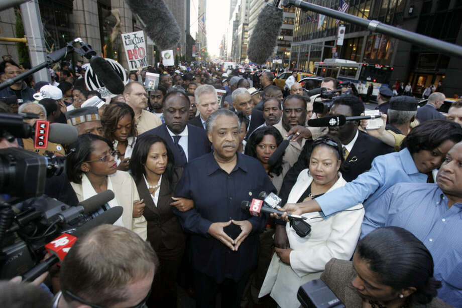 FILE - In this May 3, 2007 file photo, Rev. Al Sharpton speaks during a news interview before leading a march for decency in music on James Brown's birthday in New York. (AP Photo/Frank Franklin II, File)