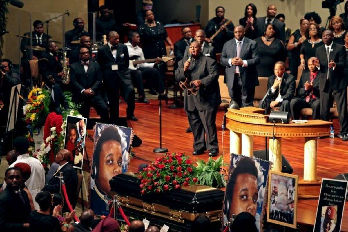 Funeral services for Michael Brown are held on Monday, Aug. 25, 2014, at Friendly Temple Missionary Baptist Church in St. Louis. Hundreds of people gathered to say goodbye to Brown, who was shot and killed by a Ferguson, Mo., police officer on Aug. 9. The more than two weeks since Michael Brown's death have been marked by nightly protests, some violent and chaotic, although tensions have eased in recent days. (AP Photo/St. Louis Post Dispatch, Robert Cohen, Pool)