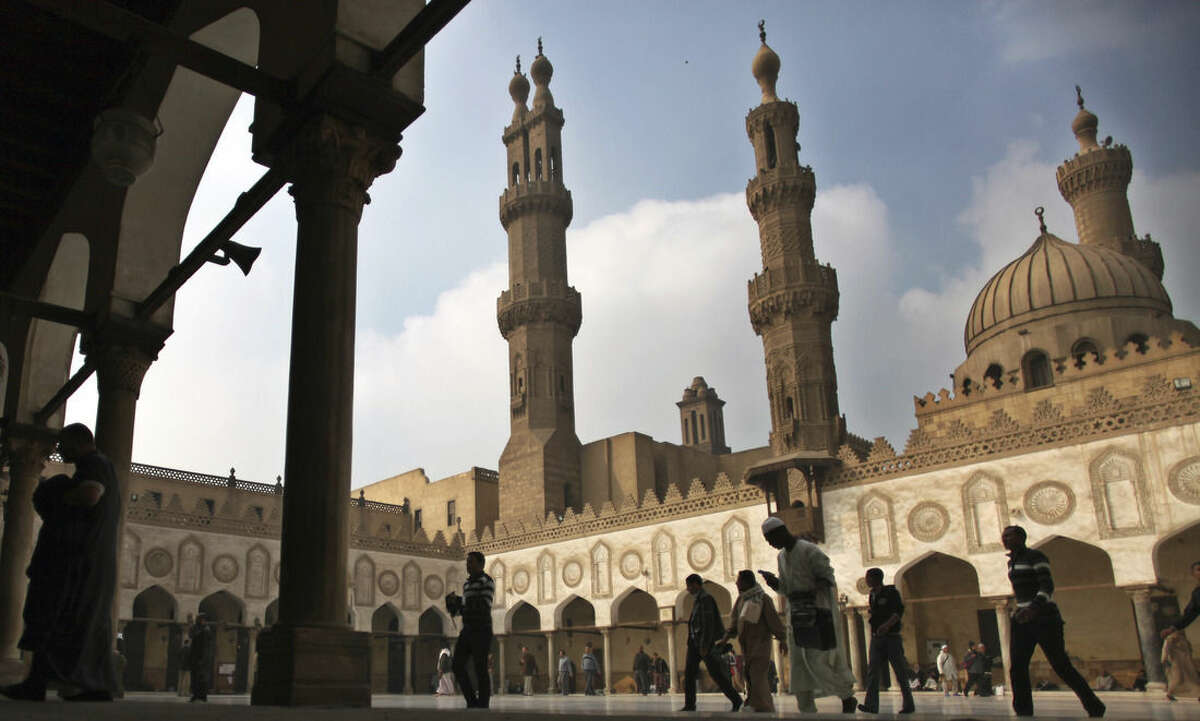 FILE - In this Friday, Dec. 28, 2012 file photo, Muslims arrive to attend the Friday prayer at Al-Azhar mosque in Cairo, Egypt. Dar el-Ifta, the top Islamic authority in Egypt, revered by many Muslims worldwide, launched Sunday an internet-based campaign aimed particularly at the West against an extremist group in Syria and Iraq, saying it is not an ?