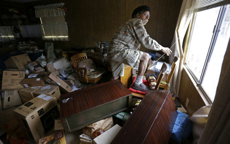 Steve Brody inspects damage to the interior of his mobile home after an earthquake Sunday, Aug. 24, 2014, at the Napa Valley Mobile Home Park, in Napa, Calif. A large earthquake caused significant damage and left at least three critically injured in California's northern Bay Area early Sunday, igniting fires, sending at least 87 people to a hospital, knocking out power to tens of thousands and sending residents running out of their homes in the darkness. (AP Photo/Ben Margot)