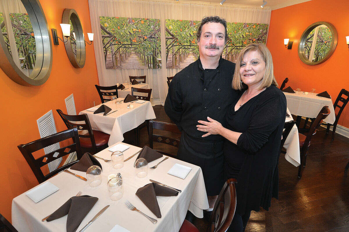 Owners Antonio and Julia Perillo in the dining room of Aranci 67 in Georgetown.