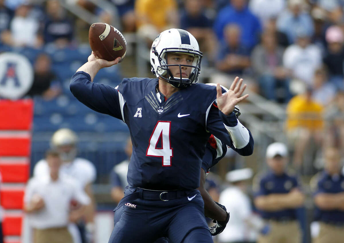Connecticut quarterback Bryant Shirreffs (4) throws a pass against Navy during the first quarter of an NCAA college football game, Saturday, Sept. 26, 2015, in East Hartford, Conn. ( AP Photo/Stew Milne)