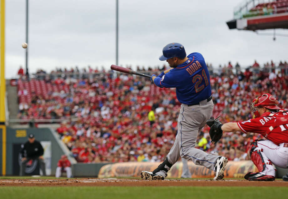 New York Met' Lucas Duda (21) hits a grand slam in the first inning of a baseball game against the Cincinnati Reds, Saturday, Sept. 26, 2015, in Cincinnati. (AP Photo/Aaron Doster)