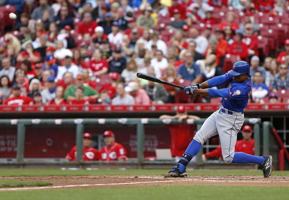 New York Mets' Curtis Granderson hits a solo home run in the second inning of a baseball game against the Cincinnati Reds, Saturday, Sept. 26, 2015, in Cincinnati. (AP Photo/Aaron Doster)