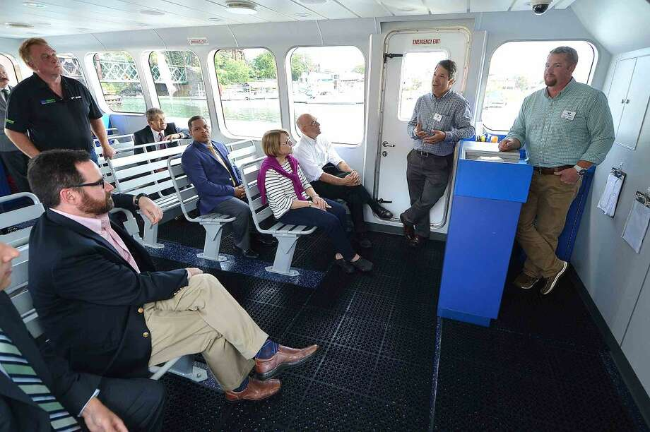 Hour Photo/Alex von Kleydorff Department of Energy and Environmental Protection Commissioner, Rob Klee tours the Maritime Aquarium's Hybrid Electric research vessel, R/V Spirit of the Sound with Aquarium President Dr. Brian Davis, State Sen. Bob Duff and Norwalk Mayor Harry Rilling