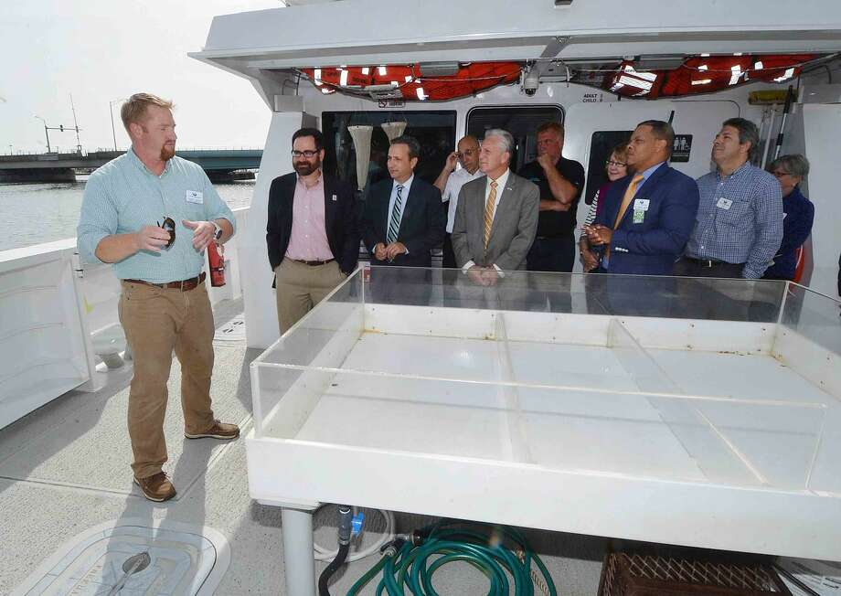 Hour Photo/Alex von Kleydorff Lead Captain Travis Mingo shows the specimen tank to Department of and Environmental Protection Commissioner, Rob Klee tours the Maritime Aquarium's Hybrid Electric research vessel, R/V Spirit of the Sound with Aquarium President Dr. Brian Davis, State Sen. Bob Duff and Norwalk Mayor Harry Rilling