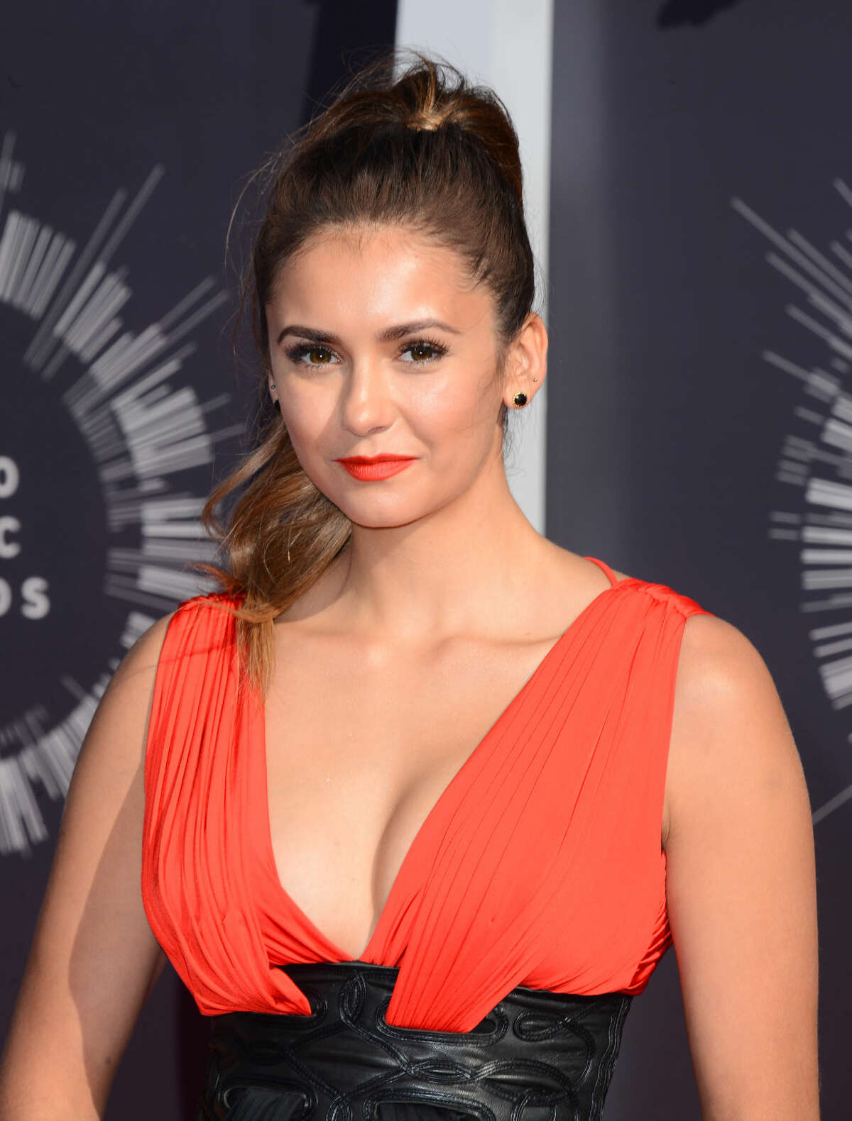 Nina Dobrev arrives at the MTV Video Music Awards at The Forum on Sunday, Aug. 24, 2014, in Inglewood, Calif. (Photo by Jordan Strauss/Invision/AP)