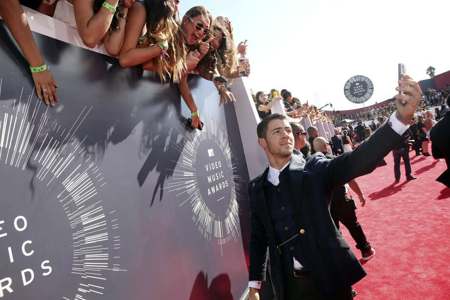 Nick Jonas arrives at the MTV Video Music Awards at The Forum on Sunday, Aug. 24, 2014, in Inglewood, Calif. (Photo by Matt Sayles/Invision/AP)