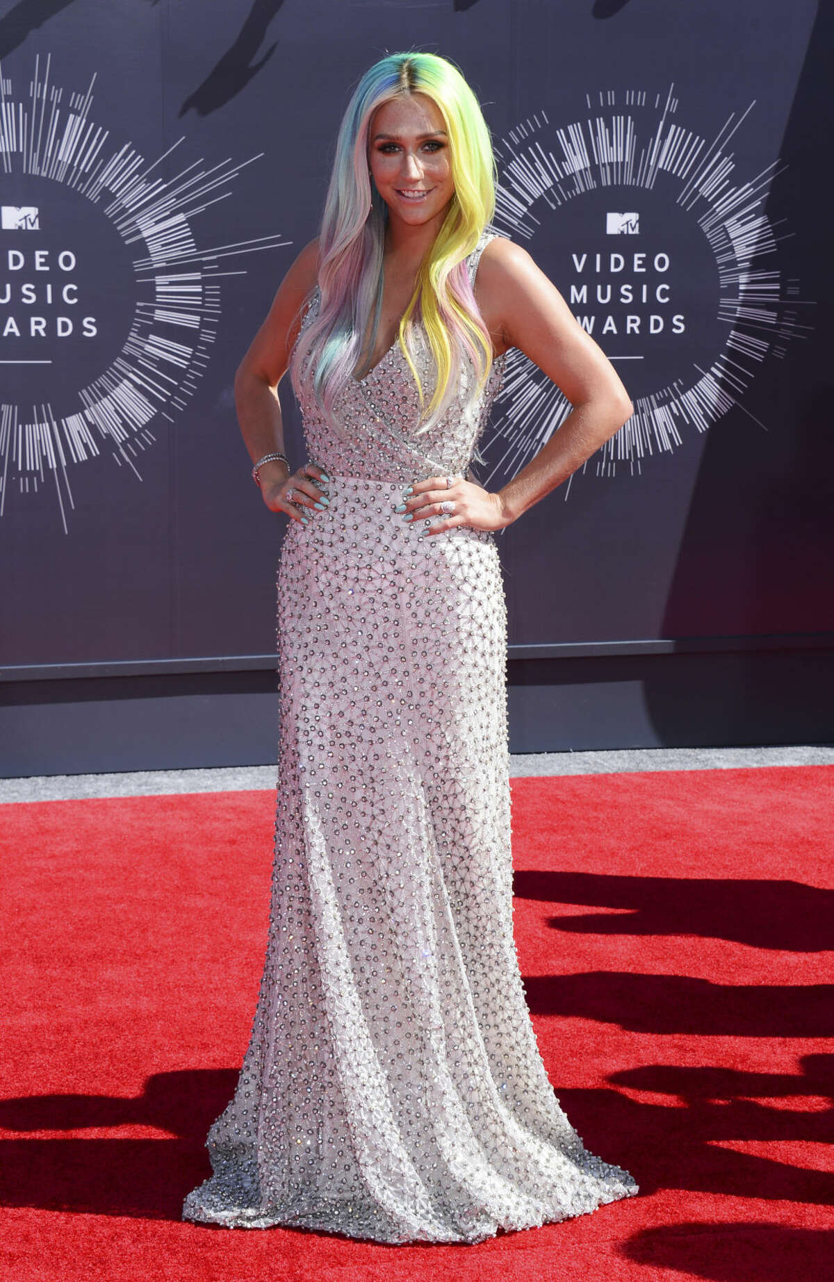 Kesha arrives at the MTV Video Music Awards at The Forum on Sunday, Aug. 24, 2014, in Inglewood, Calif. (Photo by Jordan Strauss/Invision/AP)