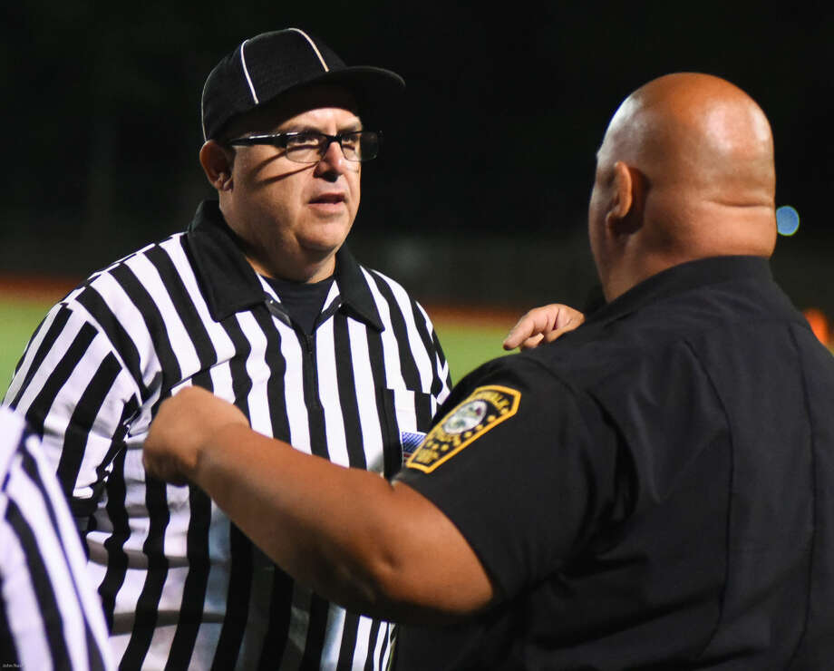 Hour photo/John Nash - Action from Friday night's Norwalk vs. Trinity Catholic football game played at Testa Field in Norwalk.