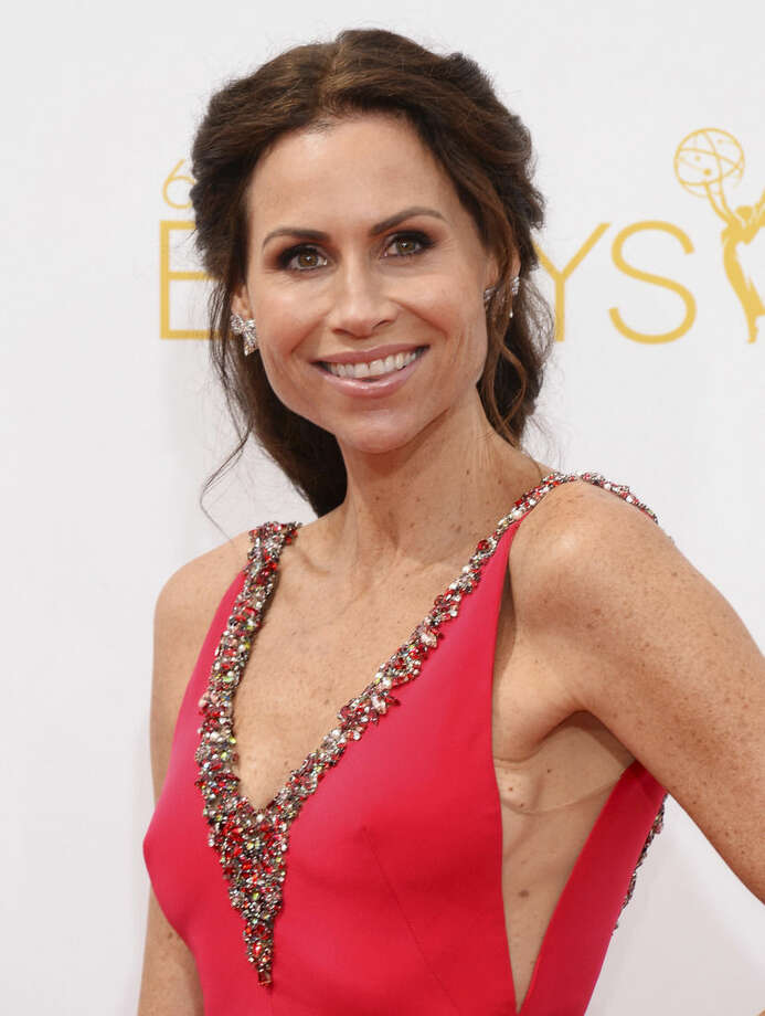 Minnie Driver arrives at the 66th Annual Primetime Emmy Awards at the Nokia Theatre L.A. Live on Monday, Aug. 25, 2014, in Los Angeles. (Photo by Jordan Strauss/Invision/AP)