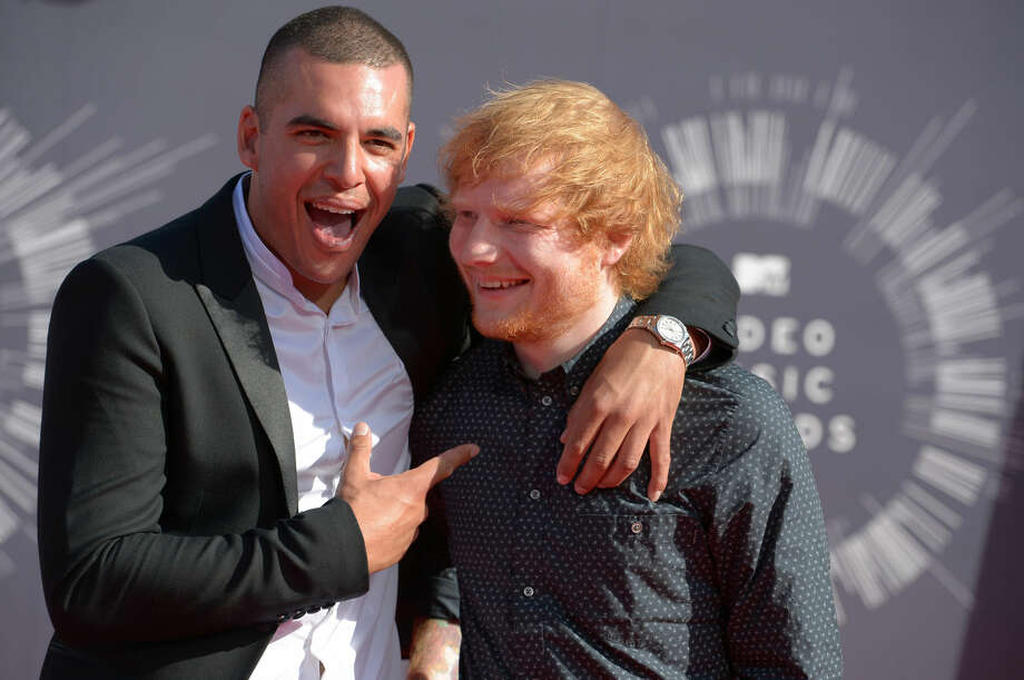 Emil Nava, left, and Ed Sheeran arrive at the MTV Video Music Awards at The Forum on Sunday, Aug. 24, 2014, in Inglewood, Calif. (Photo by Jordan Strauss/Invision/AP)