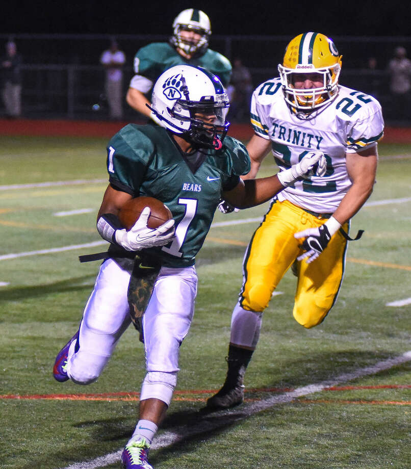 Hour photo/John Nash - Action from Friday night's Norwalk vs. Trinity Catholic football game played at Testa Field in Norwalk.