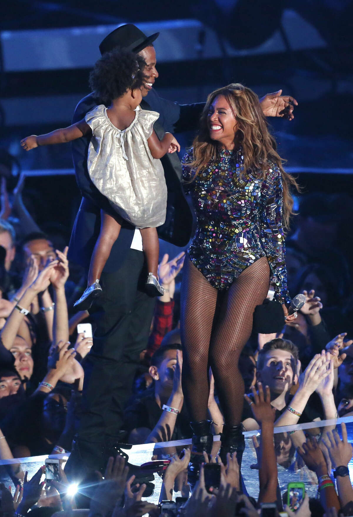 Beyonce accepts the Video Vanguard Award at the MTV Video Music Awards at The Forum on Sunday, Aug. 24, 2014, in Inglewood, Calif. Looking on from left is Blue Ivy and Jay-Z. (Photo by Matt Sayles/Invision/AP)
