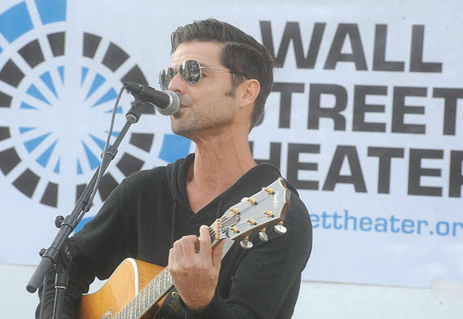 Norwalk native and singer songwriter P.J. Pacifico performs Sunday at the street festival celebrating the 100th anniversary of the Wall Street Theater. Hour photo/Matthew Vinci