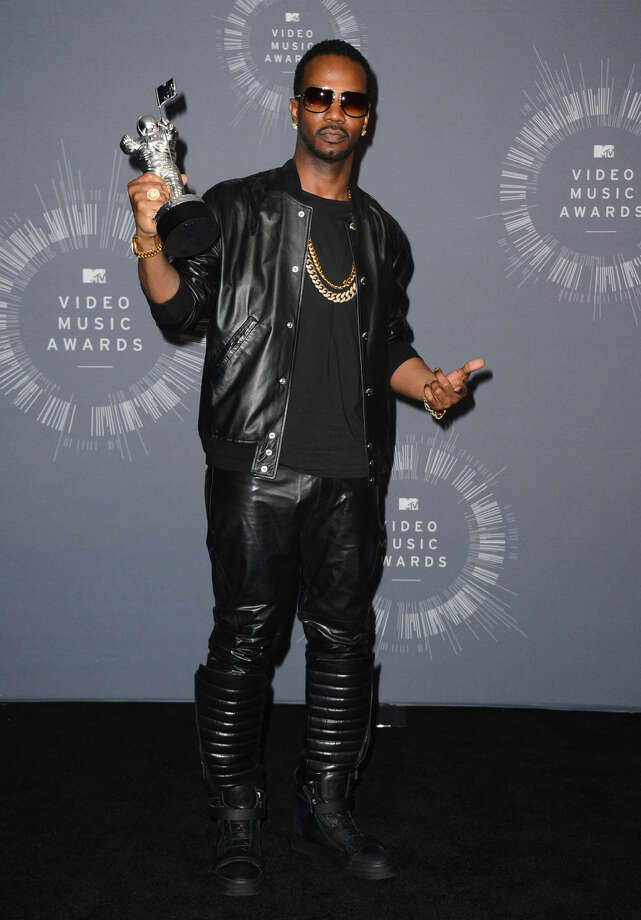 """Juicy J, featured in Katy Perry's song """"Dark Horse,"""" poses in the press room with the award for Best Female Video at the MTV Video Music Awards at The Forum on Sunday, Aug. 24, 2014, in Inglewood, Calif. (Photo by Jordan Strauss/Invision/AP)"""