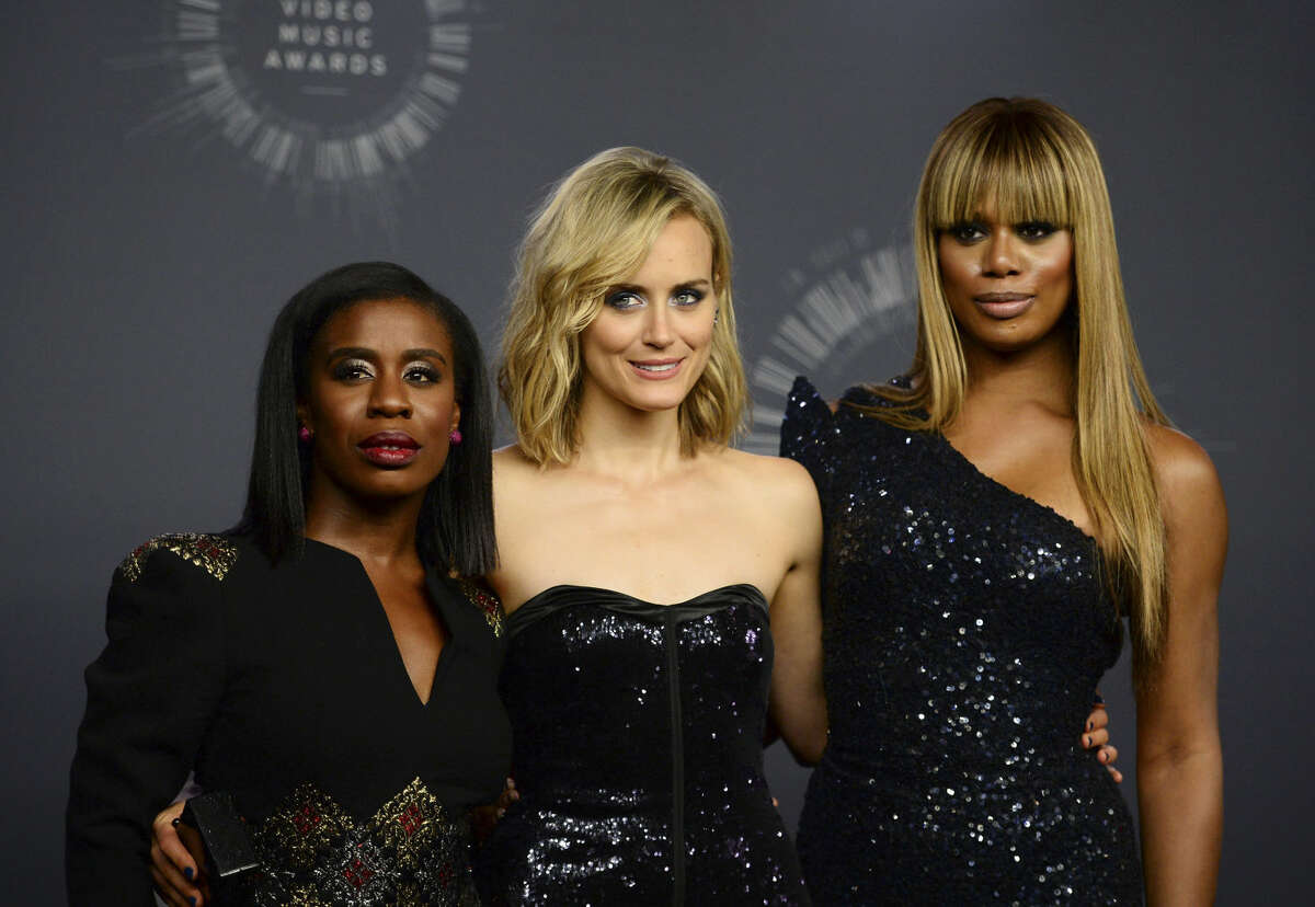 Uzo Aduba, from left, Taylor Schilling and Laverne Cox pose in the press room at the MTV Video Music Awards at The Forum on Sunday, Aug. 24, 2014, in Inglewood, Calif. (Photo by Jordan Strauss/Invision/AP)