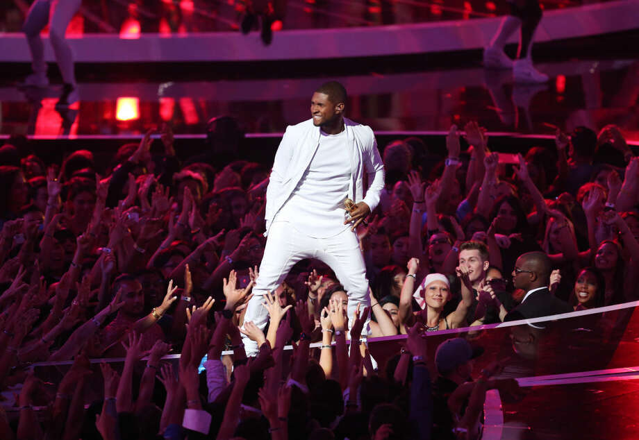 Usher performs at the MTV Video Music Awards at The Forum on Sunday, Aug. 24, 2014, in Inglewood, Calif. (Photo by Matt Sayles/Invision/AP)