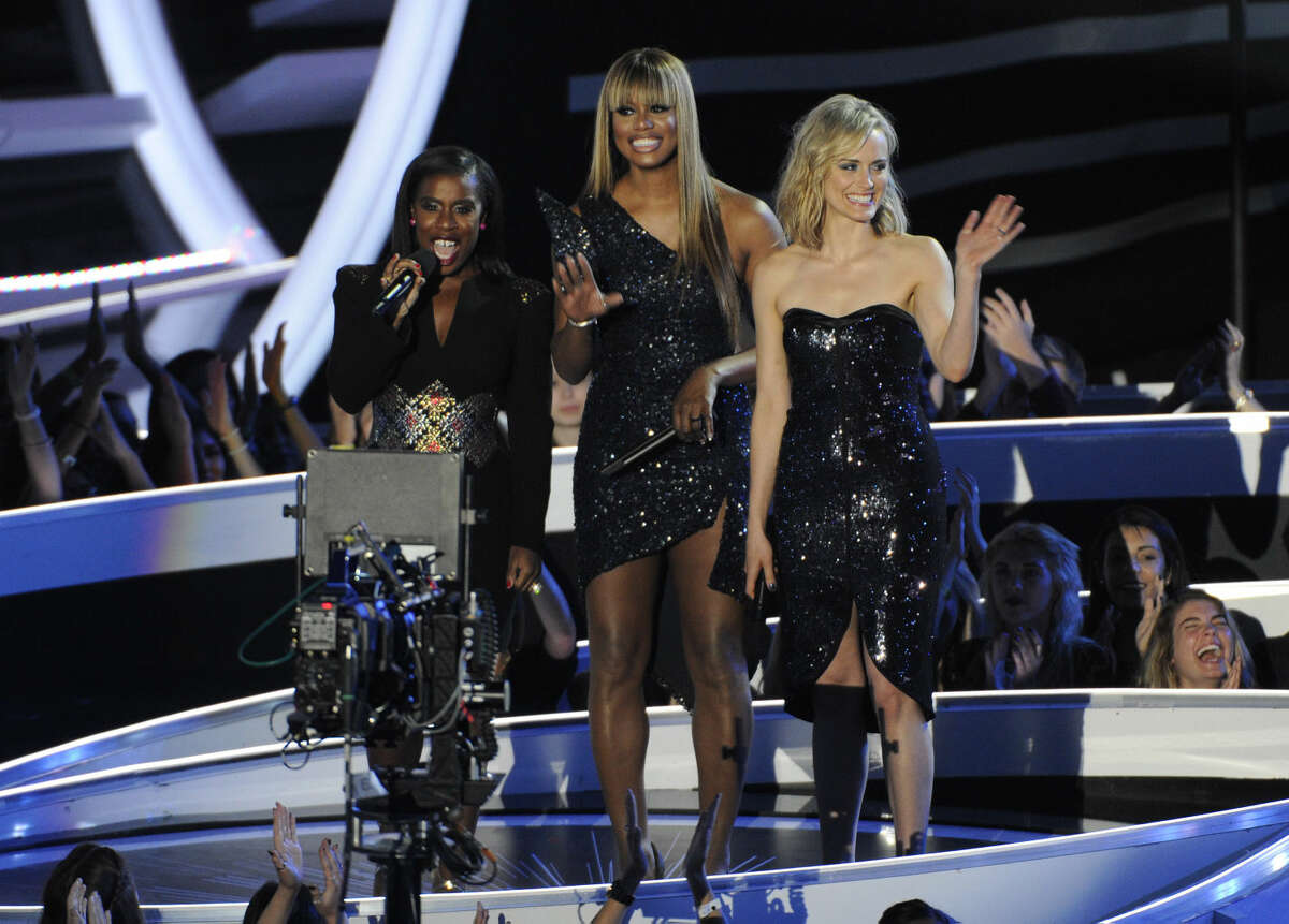 Uzo Aduba, from left, Laverne Cox and Taylor Schilling speak at the MTV Video Music Awards at The Forum on Sunday, Aug. 24, 2014, in Inglewood, Calif. (Photo by Chris Pizzello/Invision/AP)